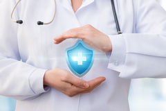 Doctor symbol health insurance. Royalty Free Stock Photo