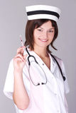 Doctor with syringe Royalty Free Stock Photo