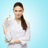 Doctor with syringe Stock Photography
