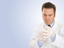 Doctor with Syringe Copyspace Royalty Free Stock Photos
