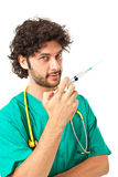 Doctor and syringe Royalty Free Stock Images