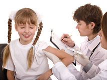 Doctor with syringe inject inoculation to child. Royalty Free Stock Images
