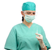 Doctor with syringe, mask, glasses and gloves Stock Photos