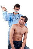 Doctor with syringe ready to give an injection to a scared patient Royalty Free Stock Photos