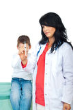 Doctor with syringe and scared kid Royalty Free Stock Image