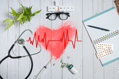 Doctor table with medical items, stethoscope and pills Stock Image