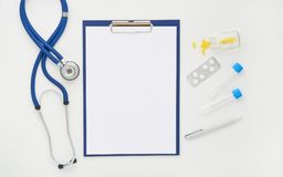 Doctor table with medicines, stethoscope and glasses, top view Royalty Free Stock Photography