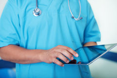 Doctor with tablet Stock Photos