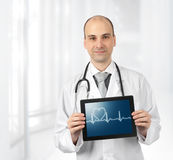 Doctor with tablet computer stock photos