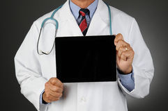 Doctor With Tablet Computer Royalty Free Stock Photography