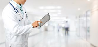 Doctor with tablet computer at hospital. Male doctor using tablet computer at hospital. Medical research staff and doctor service royalty free stock photo