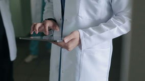 Doctor with a tablet in the corridor of the hospital stock video footage