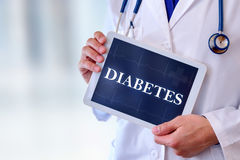 Doctor with tablet with diabetes message stock image