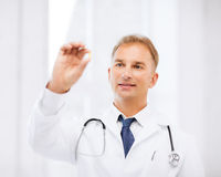 Doctor with tablet in hospital Stock Images