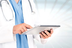 Doctor with tablet Royalty Free Stock Photography
