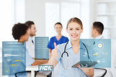 Doctor with tablet pc at clinic showing thumbs up Royalty Free Stock Photos