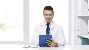 Doctor with tablet pc and clipboard in hospital stock footage