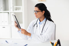 Doctor with tablet pc and clipboard at hospital Royalty Free Stock Image