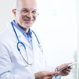 Doctor with tablet Royalty Free Stock Image