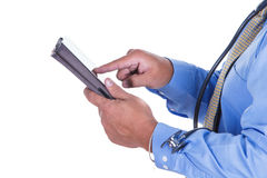 Doctor and tablet stock image