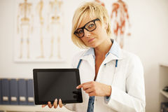 Doctor with tablet Royalty Free Stock Images