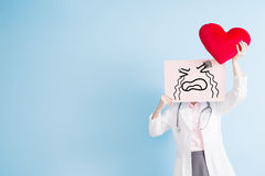 Doctor take cry billboard. Woman doctor take cry billboard and heart  on blue backgorund, asian Stock Image