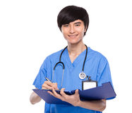 Doctor take note on file pad Royalty Free Stock Photos