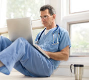 Doctor Takes A Coffee Break Stock Photography