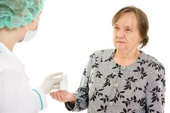 The doctor takes a bottle of pills the old woman royalty free stock images