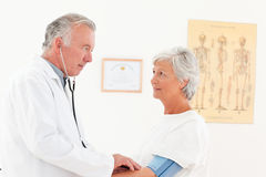 Doctor taking the blood pressure of his patient Stock Image