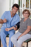Doctor taking the Blood Pressure Stock Photo