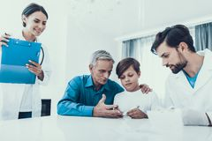 Doctor Taking Blood Sample from Boy`s Finger. Diabetes Concept. Sugar in Blood. Healthcare Concept. Young Man in Uniform. White Coat. Medical Equipment. Boy stock photos