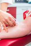 Doctor taking blood sample Stock Images