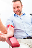 Doctor taking blood sample Royalty Free Stock Photo