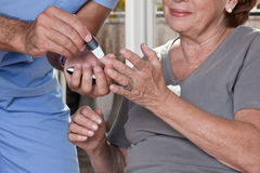 Doctor taking a Blood Sample. From a female patient's royalty free stock photography
