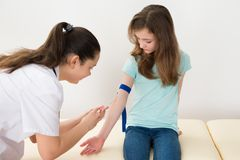 Doctor Taking Blood Sample From Patient Stock Images