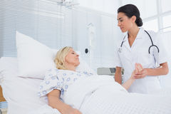 Doctor taking care of patient Stock Photo