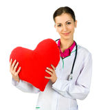 Doctor taking care of red heart symbo Royalty Free Stock Images