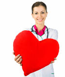 Doctor taking care of red heart symbo Stock Images