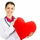 Doctor taking care of red heart symbo Royalty Free Stock Photos