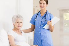 Doctor taking care of suffering senior patient Stock Photo