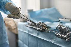 Doctor is taking forceps Royalty Free Stock Image