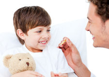 A doctor taking little boy's temperature Royalty Free Stock Photography