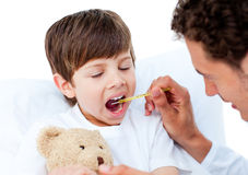 Doctor taking little boy's temperature Royalty Free Stock Photo