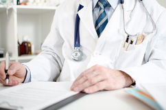 Doctor taking notes Stock Photos
