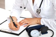 Doctor taking notes about patient Royalty Free Stock Photos