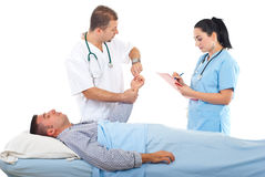 Doctor taking patient pulse Stock Photo
