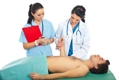 Doctor taking pulse to male patient Royalty Free Stock Photo