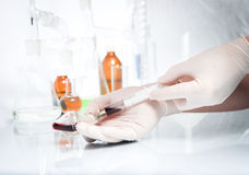 Doctor  taking some blood samples Royalty Free Stock Image