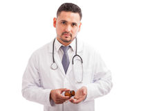Doctor taking some pills from a bottle Royalty Free Stock Photos